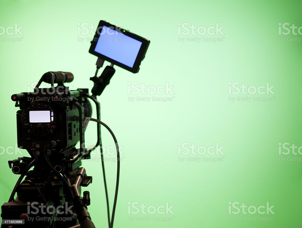 Television Camera on Green Screen Background stock photo