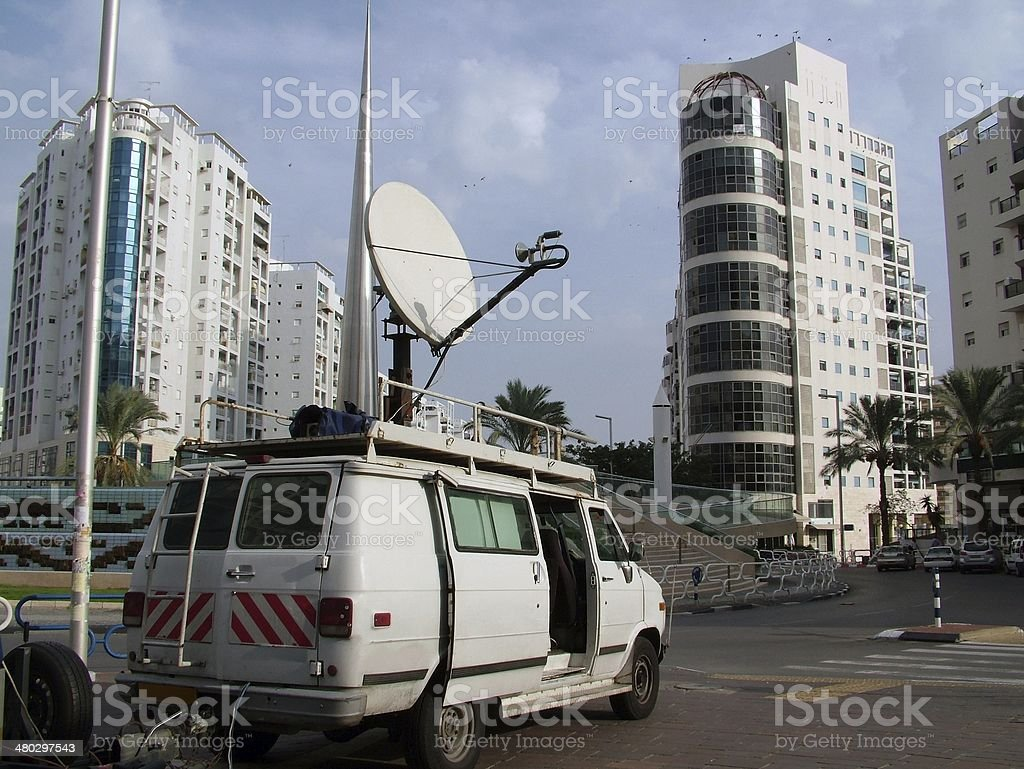 television news reporter truck with satellite dish stock photo