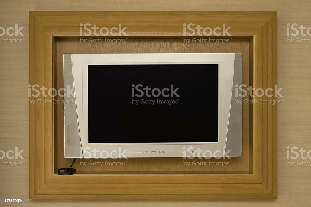 LCD Television on the wall in wooden frame royalty-free stock photo