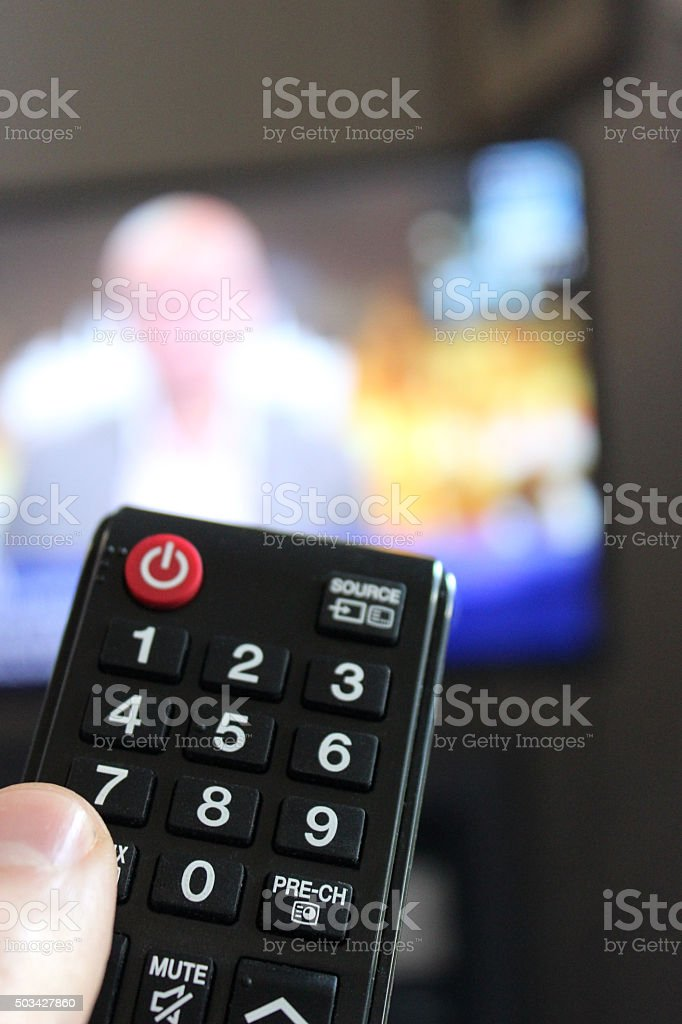 Television Remote Control in Human Hand stock photo