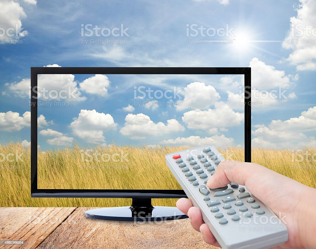 Television remote control watching tv stock photo