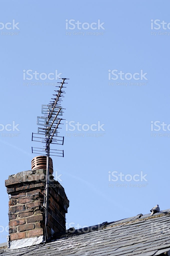 Television signal receiving aerials on a slate roof royalty-free stock photo