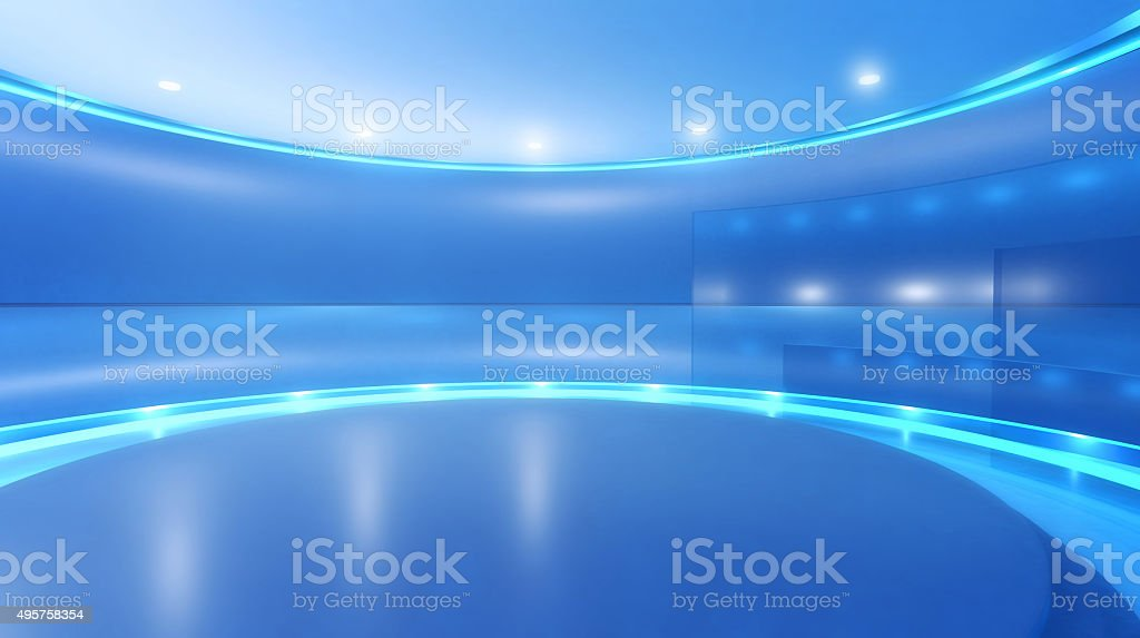 Television studio background with stage and blue lights stock photo