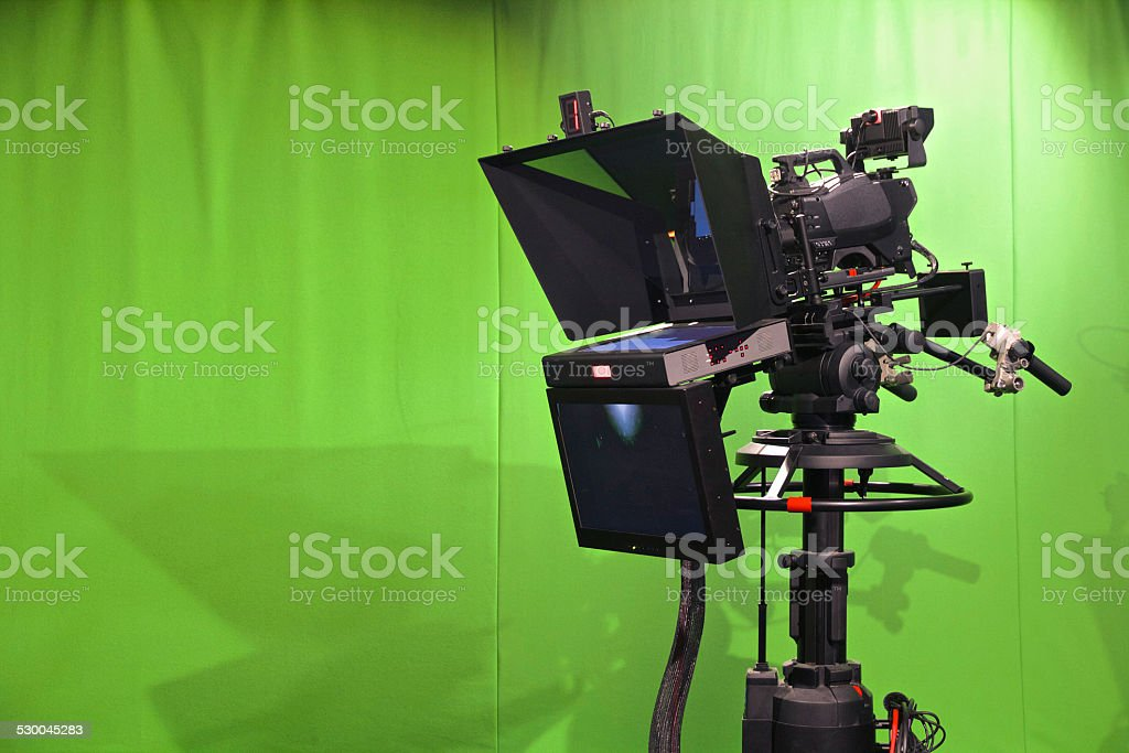 Television Studio Camera with chroma key green backdrop stock photo