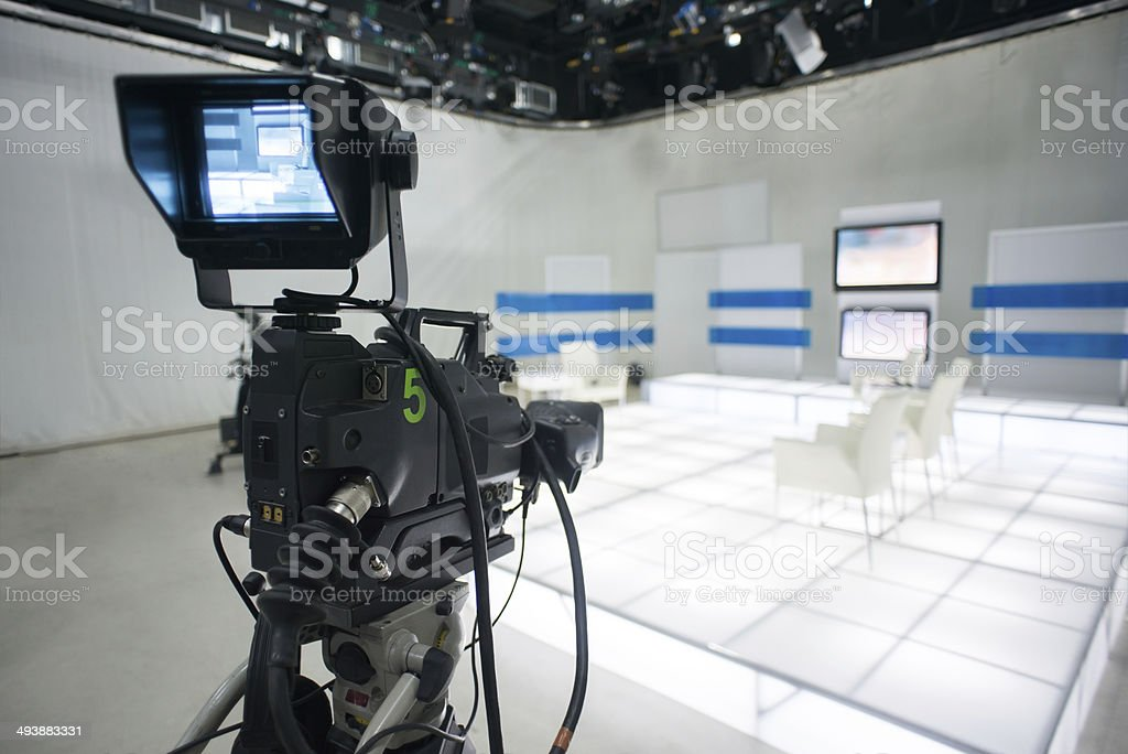 Television studio with camera and lights stock photo