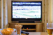 Television, TV watching (baseball match) with snacks and alcohol