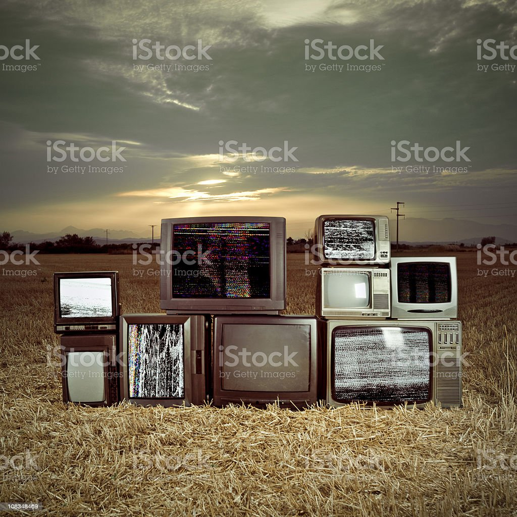 Televisions in the darkness royalty-free stock photo
