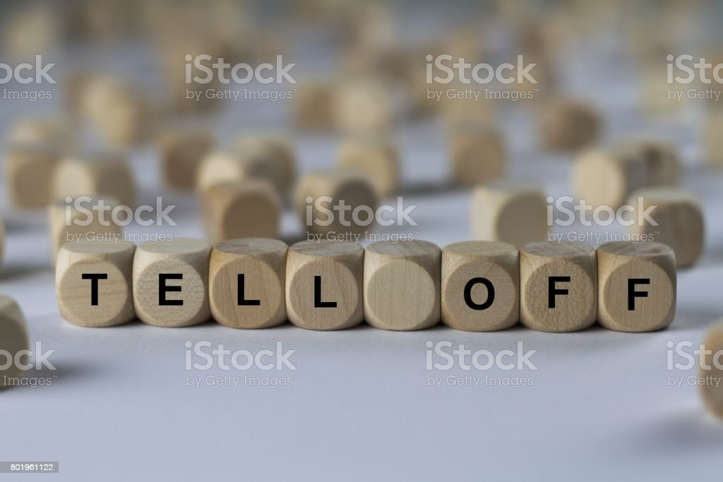 tell off - cube with letters, sign with wooden cubes stock photo