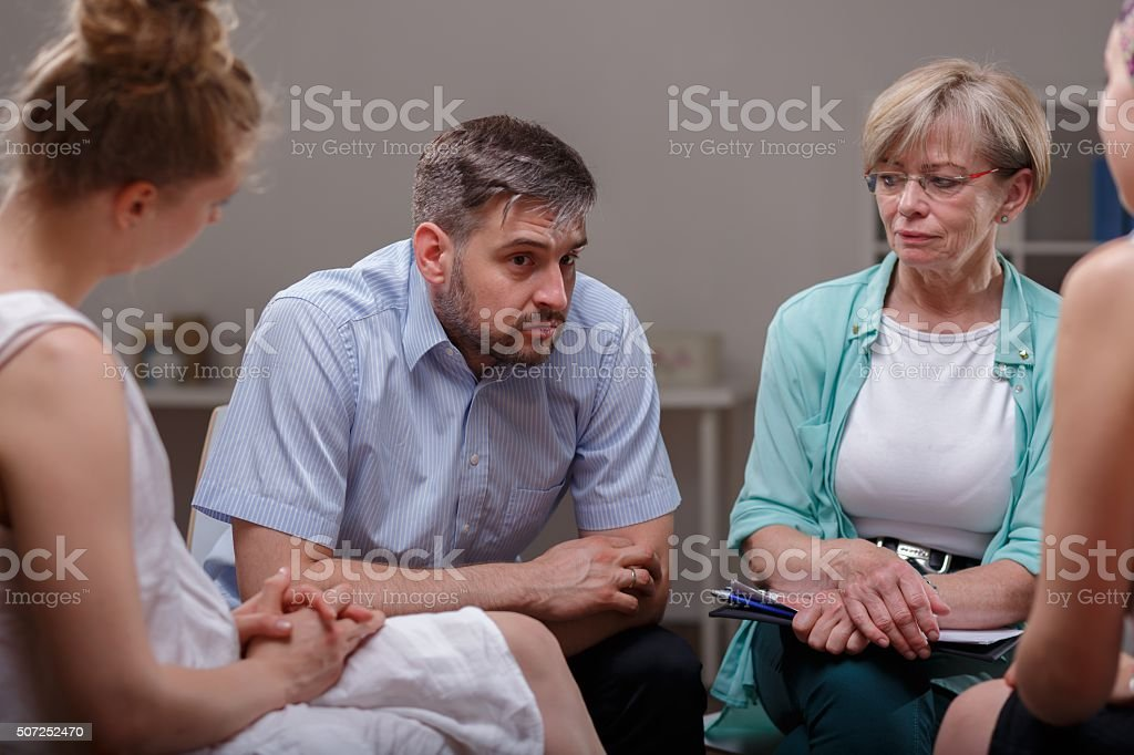 Telling about problems during therapy stock photo