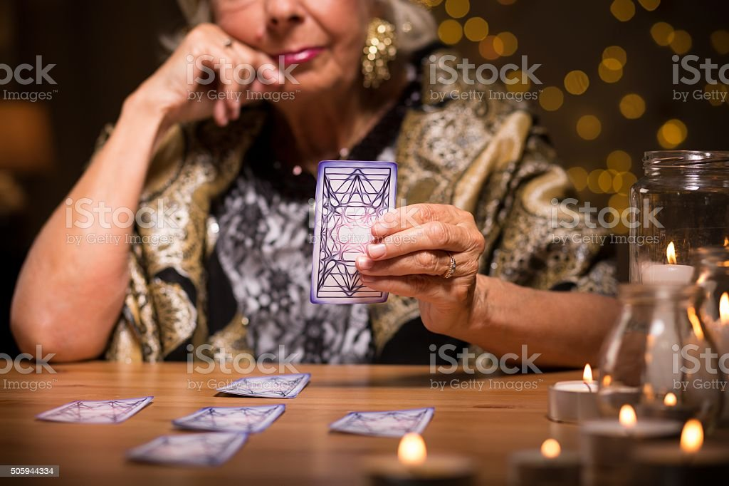 Telling fortune from tarot cards stock photo