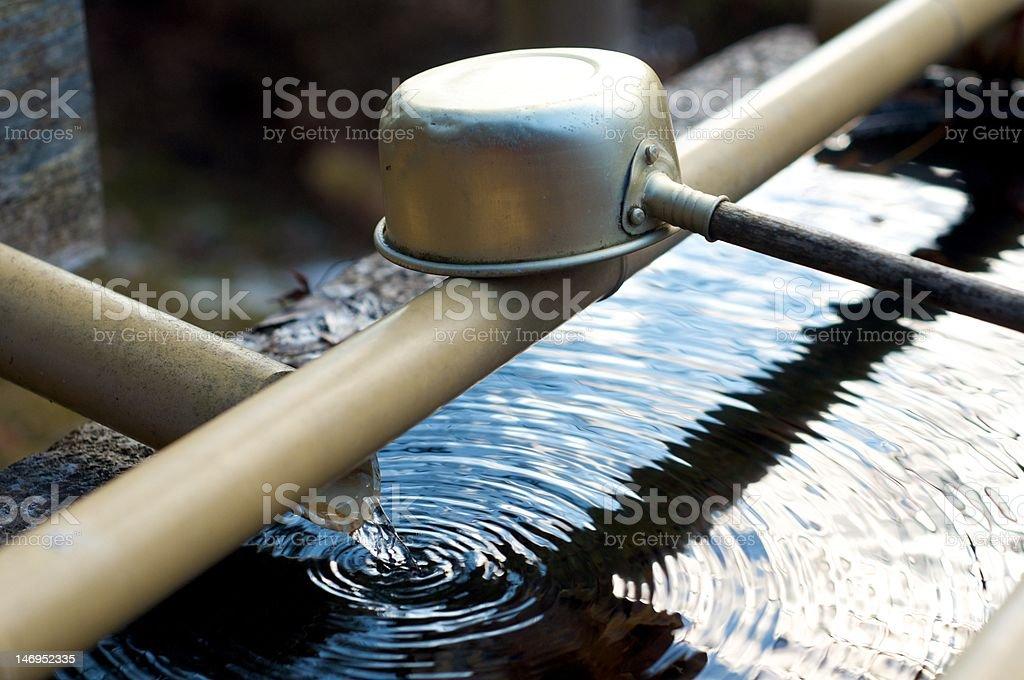 Temizuya water trough at a shrine stock photo