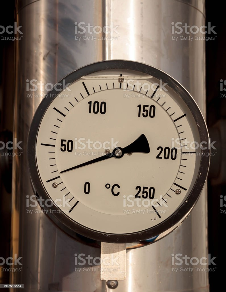 temperature gauge connect with pipeline background. stock photo