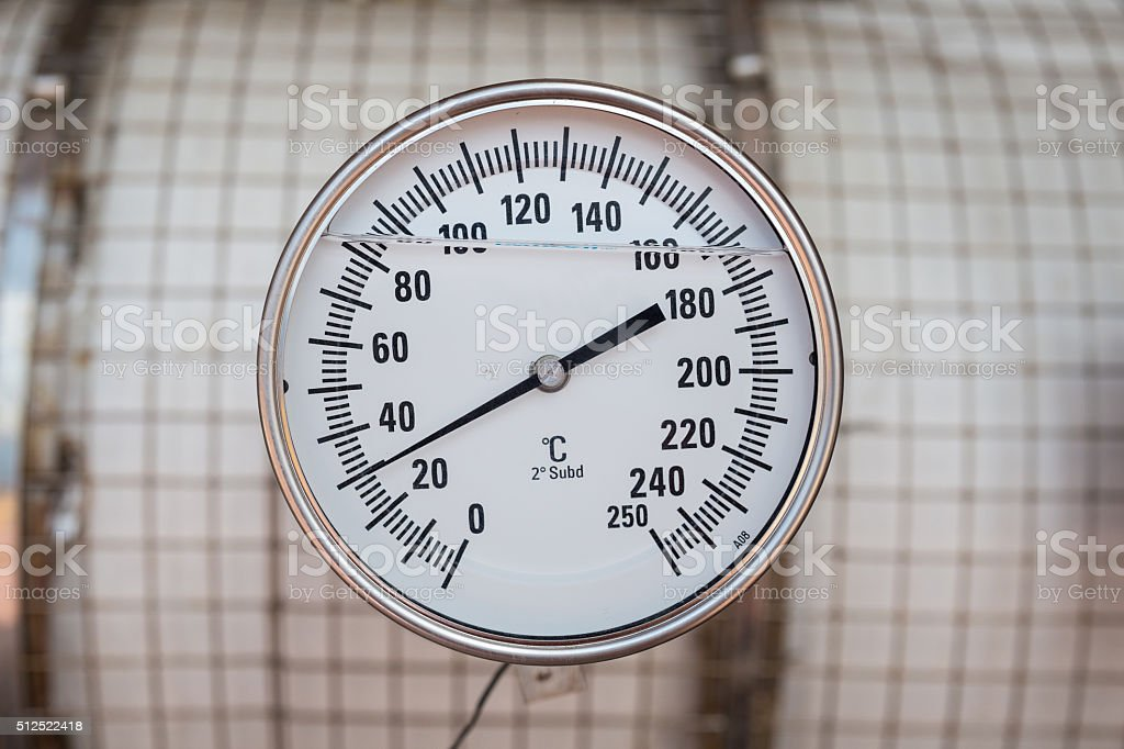 Temperature gauge in degree unit install at gas booster compressor stock photo