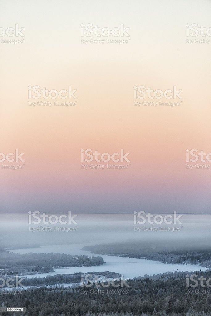 Temperature inversion over Lapland river at dawn stock photo