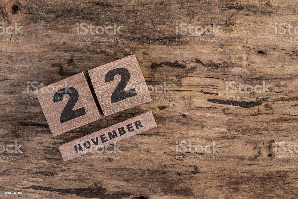 wooden calendar for november on wooden background