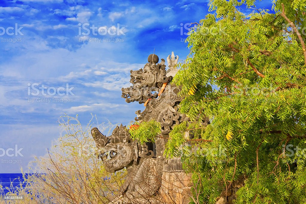 Temple among trees on an ocean coast. Indonesia. Bali. stock photo