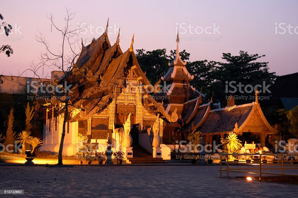 Temple at sunset, Wat Chedi Luang complex , Chiang Mai stock photo