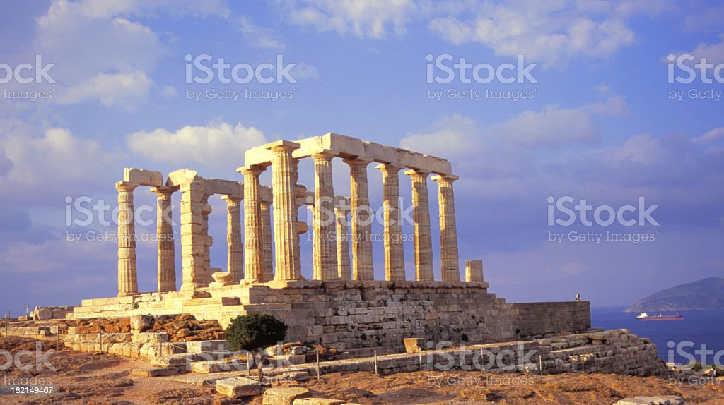 Temple of Poseidon on a partly cloudy day stock photo