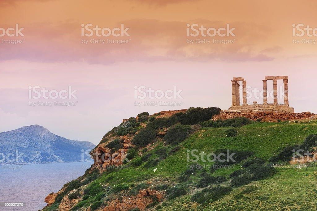 Temple of Poseidon on green hill near sea, Greece stock photo