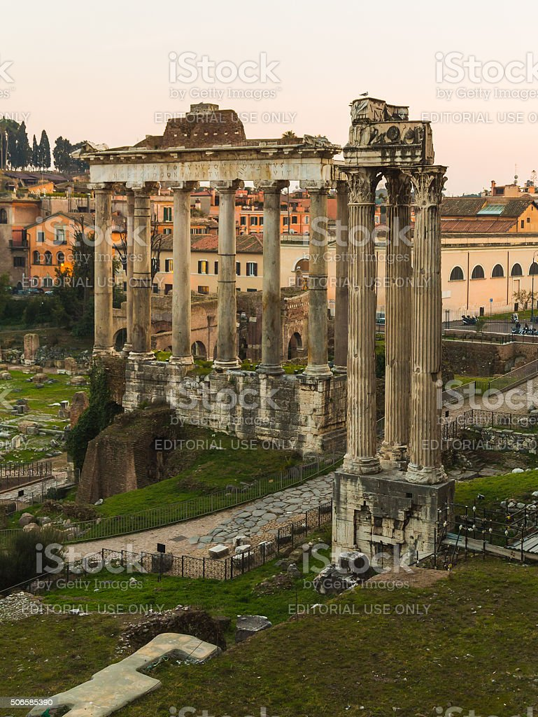 Temple of Saturn and Temple of Vespasian and Titus stock photo