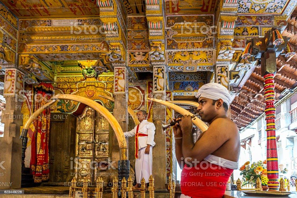 Temple of the Tooth, horn player Kandy, Sri Lanka stock photo