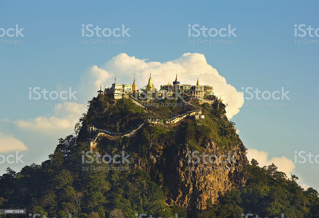temple on top of a mountain Popa in the clouds stock photo