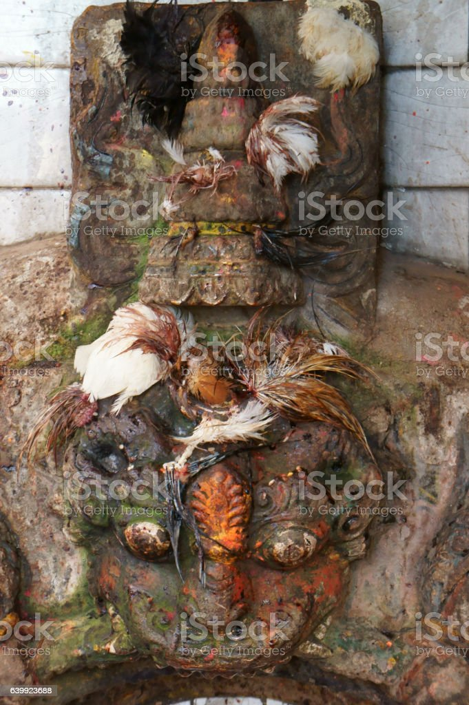 Temple shrine spilled with reminders of offerings and sacrifices stock photo