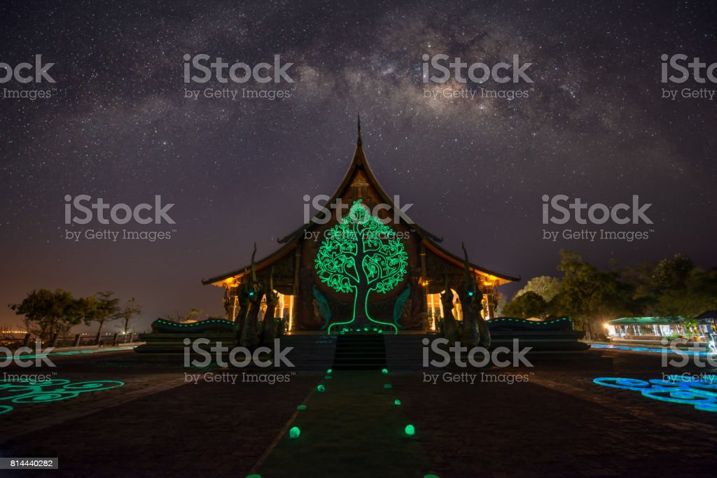 Temple Sirindhorn Wararam Phuproud in Ubon Ratchathani Province at night and The Milky Way is our galaxy. This long exposure astronomical stock photo