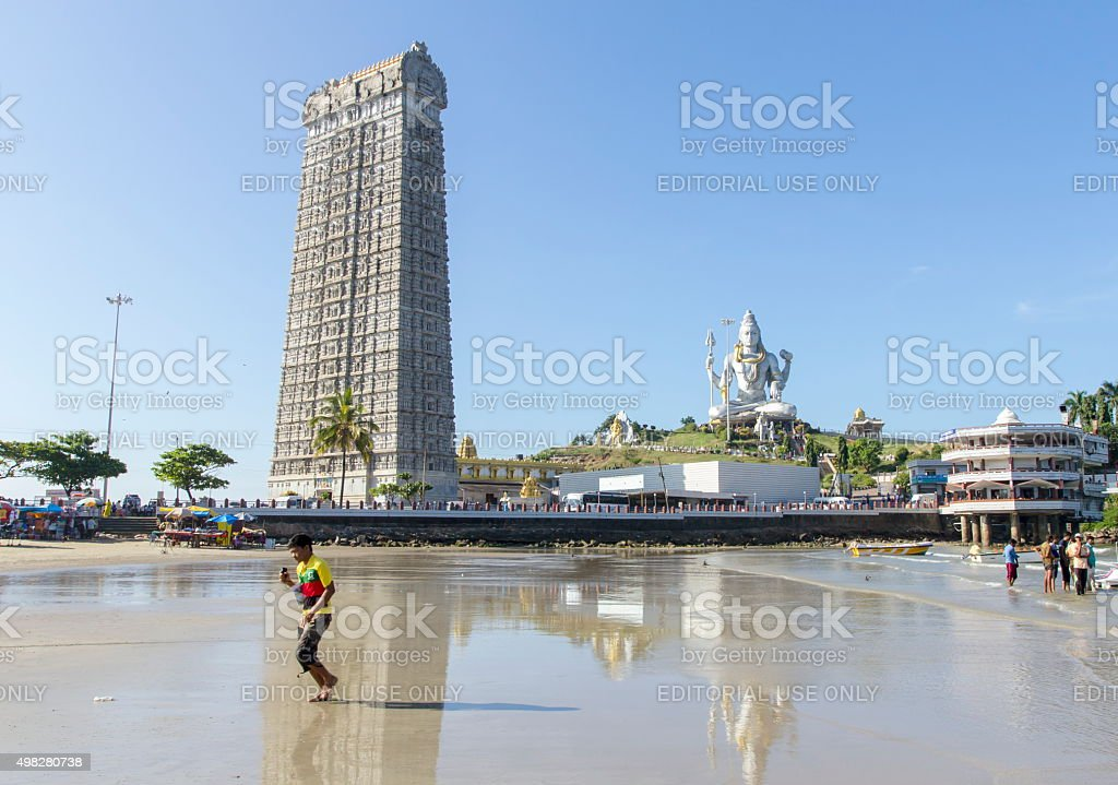 Temple tower and Shiva statue, Murudeshwar, Karnataka, India stock photo