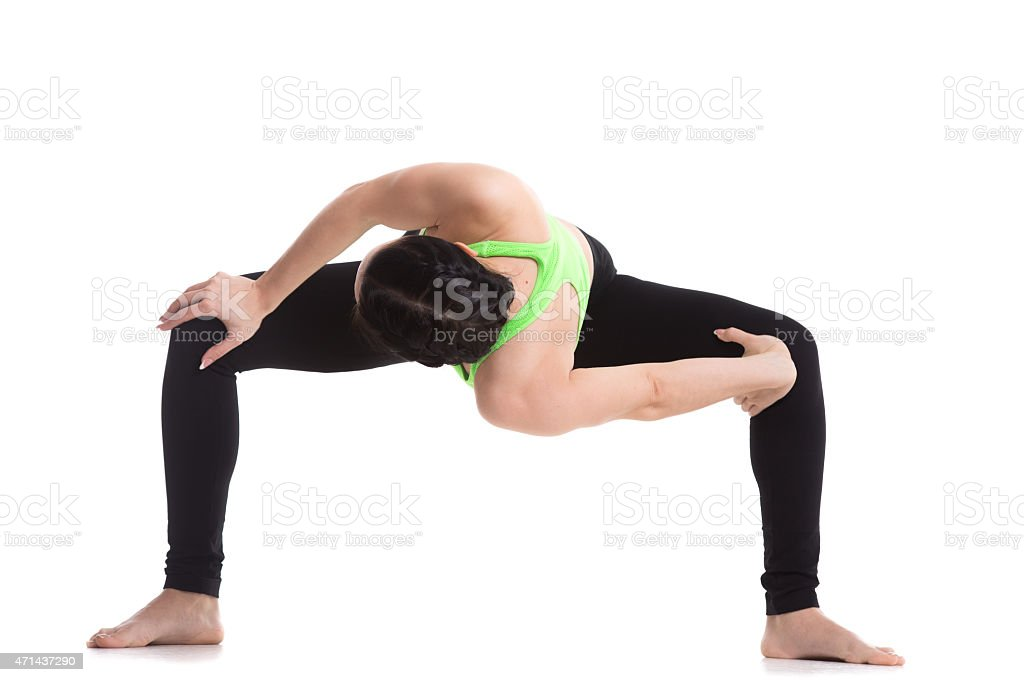 Temple twist yoga pose stock photo