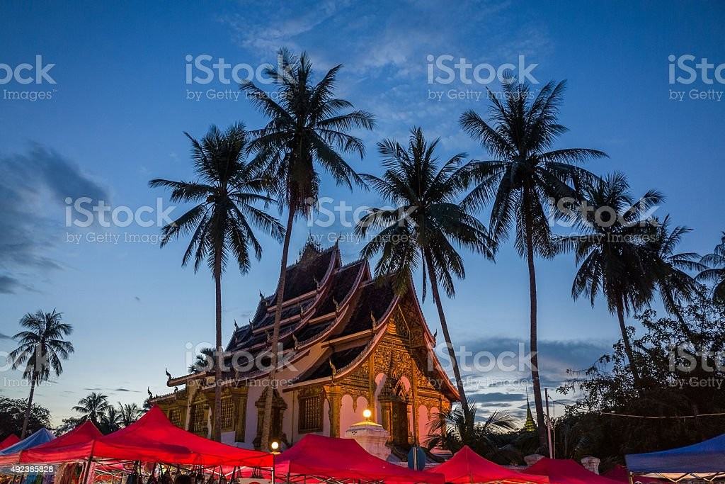 Temple with Palm Trees in Night Market stock photo