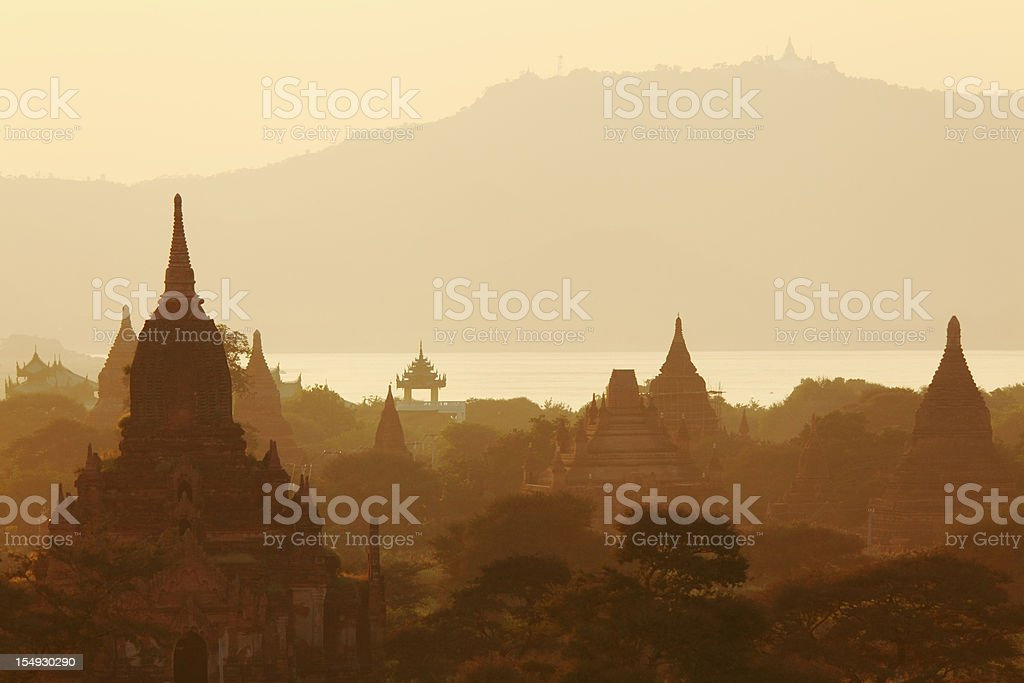 temples and mountains at Bagan after sunrise royalty-free stock photo