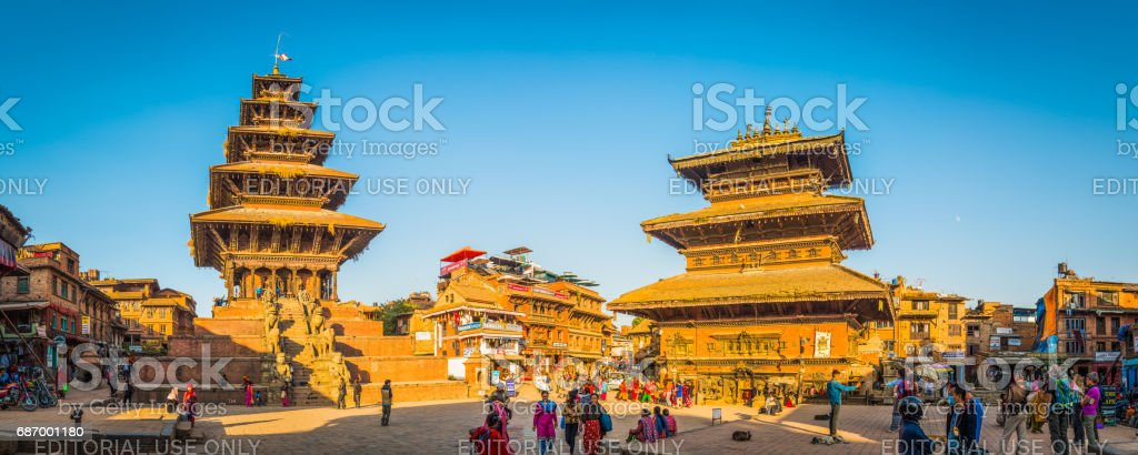 Temples and tourists illuminated by warm sunset light Kathmandu Nepal stock photo