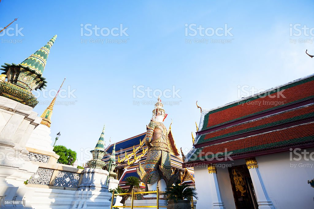 Temples and warrior statue in Wat Phra Kaeo stock photo