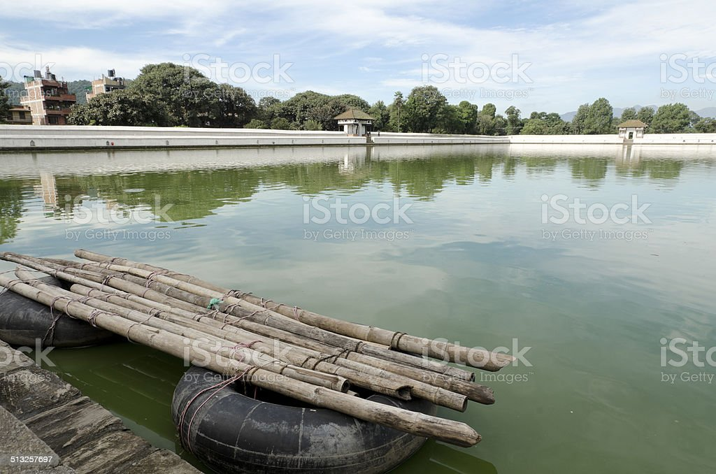 Temporary boat with inflated tire stock photo