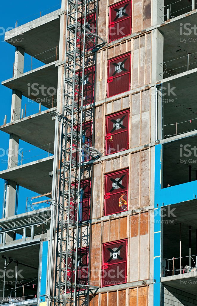 Temporary Elevator Outside Building Under Construction stock photo