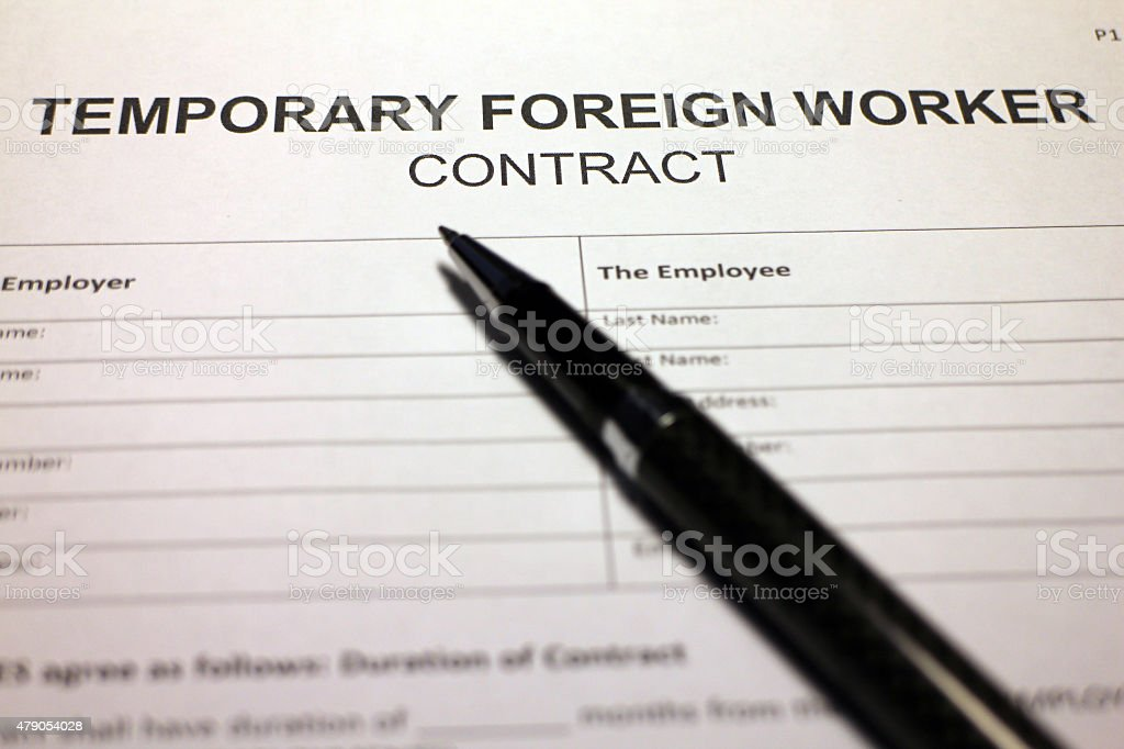 Temporary Foreign Worker Contract Agreement stock photo