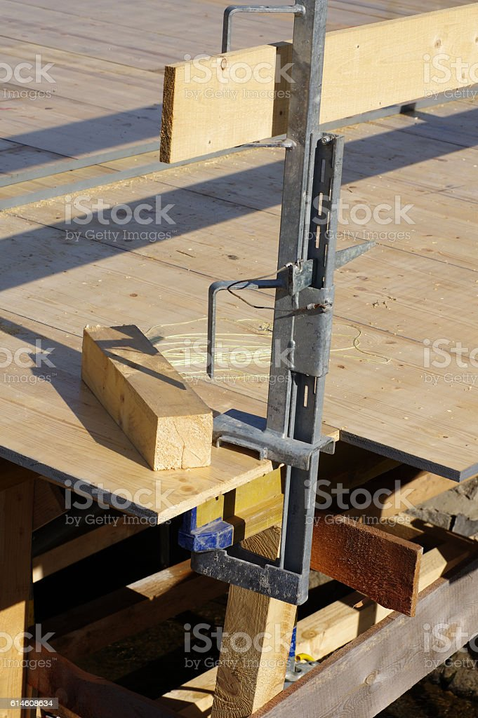 Temporary wood forms, safety handrails stock photo
