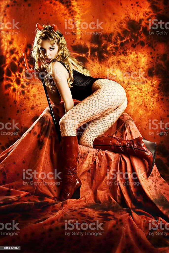 Temptating she-devil in hell. stock photo