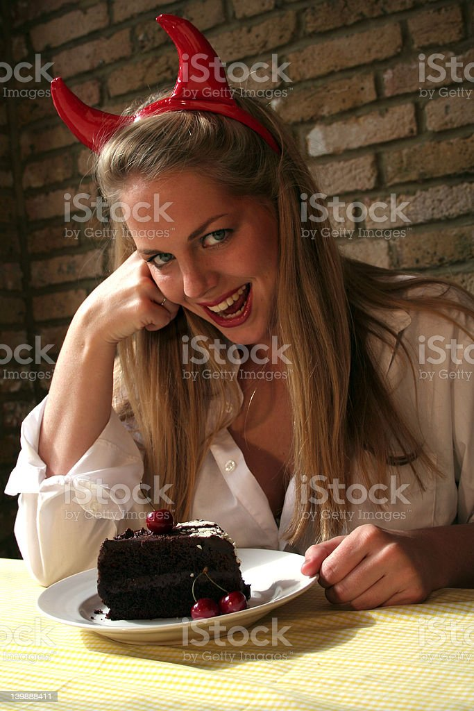 Temptation - Devil Woman versus Chocolate Cake royalty-free stock photo