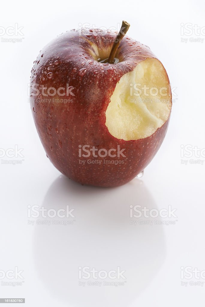 Temptation - taking a bite of the apple royalty-free stock photo