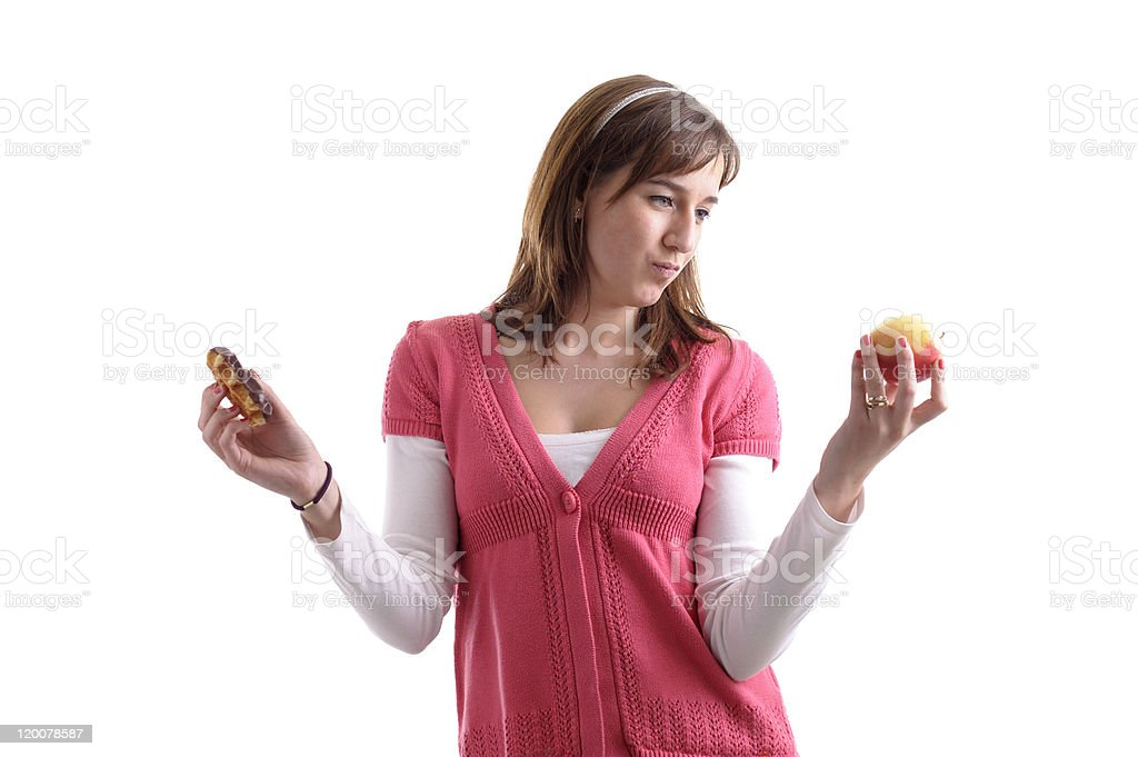 Tempted between junk and healthy food royalty-free stock photo