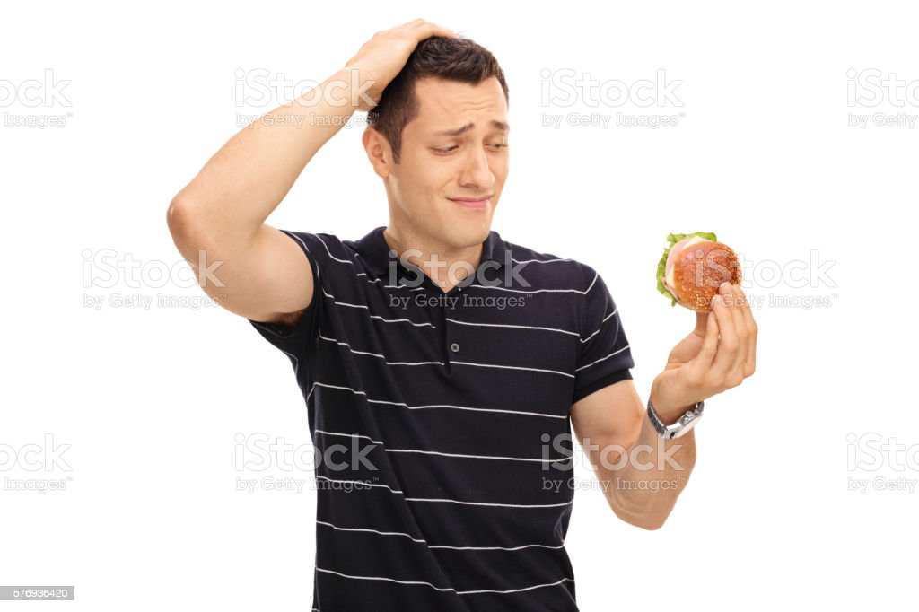 Tempted guy looking at a sandwich stock photo