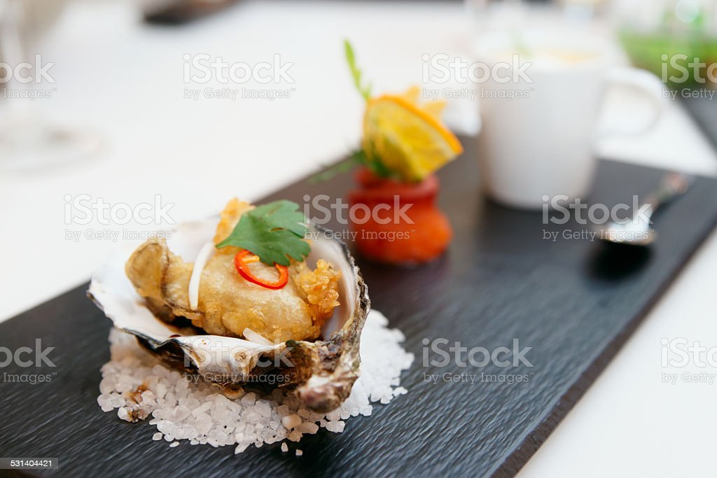 Tempura fried oyster in shell stock photo