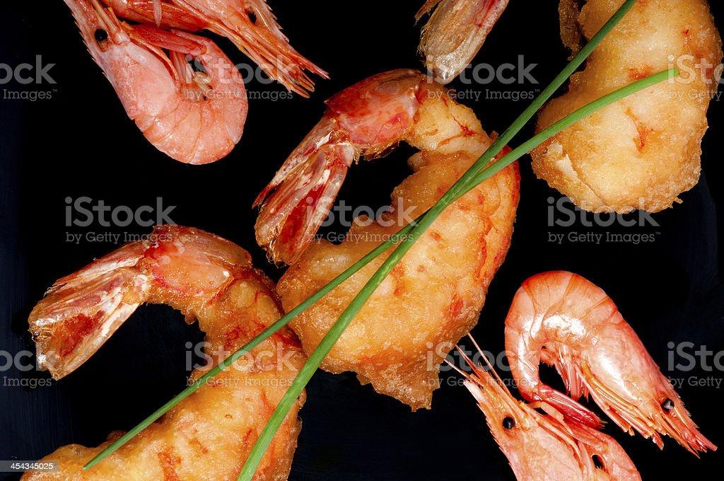Tempura prawns and shrimps on black. stock photo