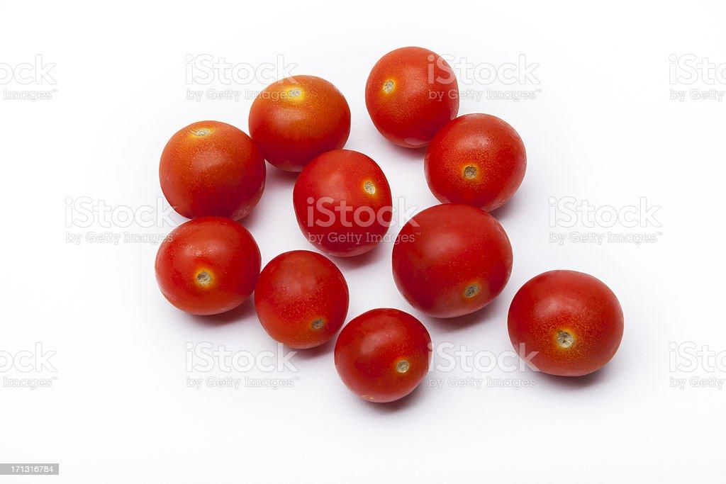 Ten Cherry tomatoes on a white surface stock photo