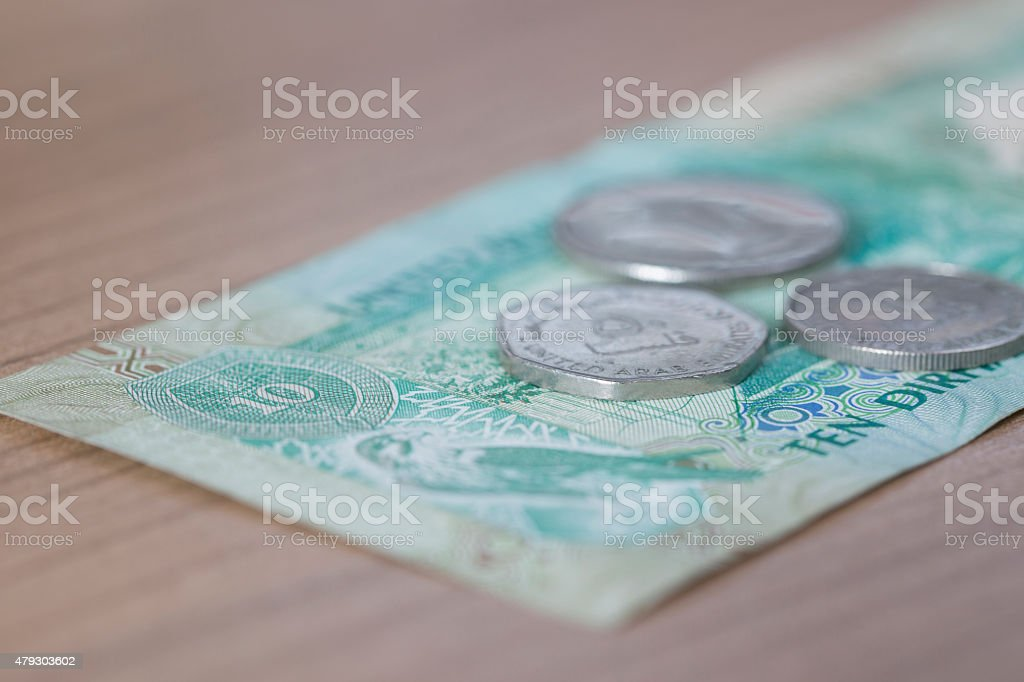 Ten Dirham Note and Coins stock photo