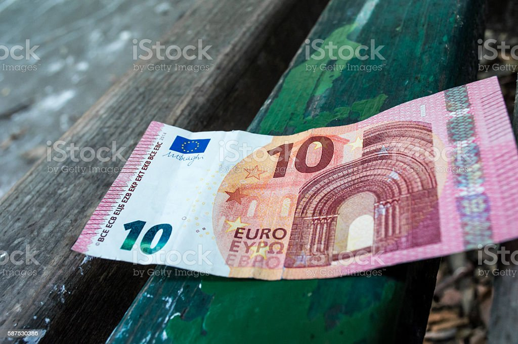 Ten Euro Note/Money on a Park Bench Close Up stock photo