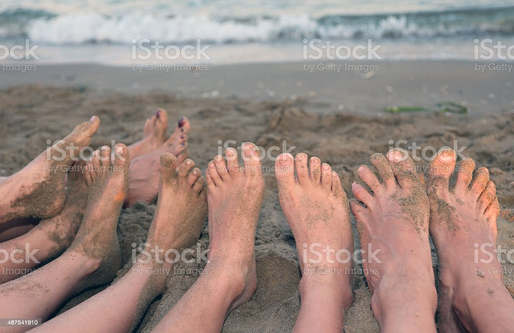 ten feet of a family by the sea stock photo