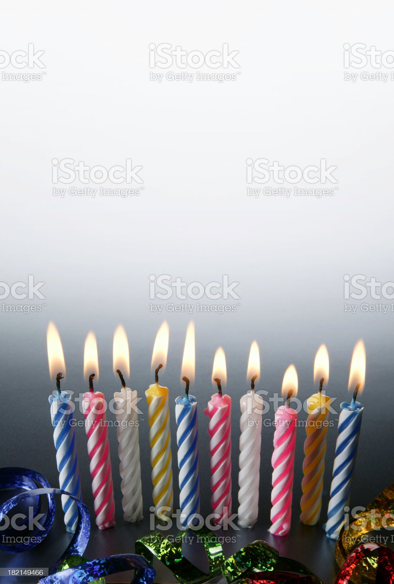 Ten lit birthday candles in a row royalty-free stock photo